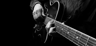 Guitarist hands and guitar close up. Playing electric guitar. play the guitar Royalty Free Stock Photography