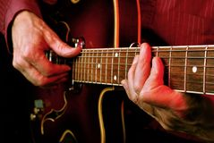 Guitarist hands and guitar close up. Playing electric guitar. play the guitar Royalty Free Stock Image