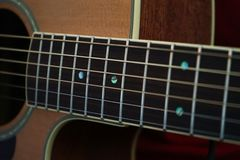 Guitarist hands and guitar close up. Guitarist playing classic acoustic guitar with his fingers, finger-picking style stock photo