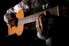 Guitarist hands and guitar close up. Playing classic guitar. Play the guitar. Low key image stock images