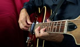 Guitarist hands and guitar close up. playing electric guitar. stock images