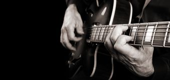 Guitarist hands and guitar close up. playing electric guitar. copy spaces. black and white. royalty free stock photography