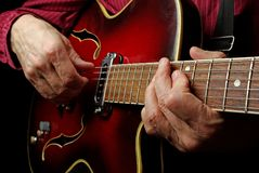 Guitarist hands and guitar close up. playing electric guitar. play the guitar. Close up Stock Photography