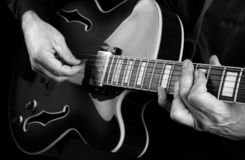 Guitarist hands and guitar close up. playing electric guitar. play the guitar. black and white. royalty free stock images