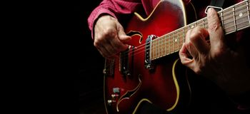 Guitarist hands and guitar close up. Playing electric guitar. play the guitar Stock Photo