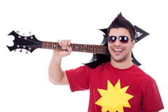 Guitarist with his guitar on shoulder Stock Photos