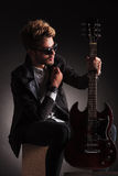 Guitarist holding his electric guitar and collar Royalty Free Stock Photo