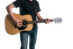Guitarist in jeans and a black T-shirt, playing an acoustic guitar with a slider, on the left side of the frame, on a white backgr Royalty Free Stock Photos