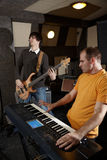 Guitarist and keyboard player is working in studio Royalty Free Stock Photography