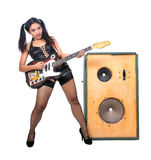 Guitarist with a large speaker Royalty Free Stock Images