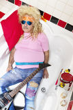 Guitarist lying in bathtub Stock Images