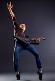 Guitarist  making a rock gesture Stock Photography