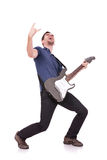 Guitarist making a rock and roll gesture Stock Photography