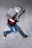 Guitarist. Man with guitar jump in the air Stock Images