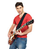 Guitarist  man plays on the electric guitar Stock Images