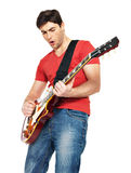 Guitarist  man plays on the electric guitar Royalty Free Stock Photo