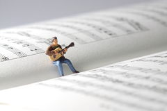 Guitarist music book A Royalty Free Stock Photo