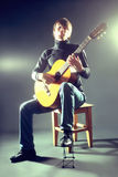 Guitarist musician guitar acoustic playing. Royalty Free Stock Photos