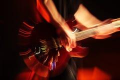 Guitarist in nightclub, blur in moving Stock Image