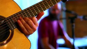 Guitarist and percussionist in a pub. Filmed in a small microbrewery pub during a concert stock footage