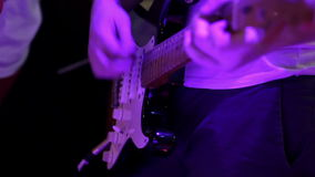 Guitarist perform at a concert stock video footage