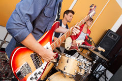 Guitarist Performing With Band In Recording Studio Stock Photography