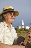 Guitarist performing at lighthouse. Concert. Low Head, Tasmania, Australia Stock Photography