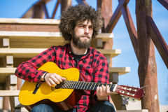 Guitarist with plaid shirt Stock Images