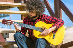 Guitarist with plaid shirt Stock Photography