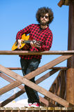Guitarist with plaid shirt Stock Photos