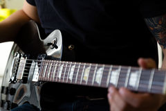 Guitarist play on electric guitar Stock Photo