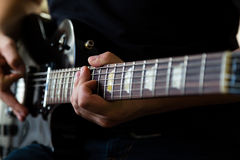 Guitarist play on electric guitar Royalty Free Stock Photography
