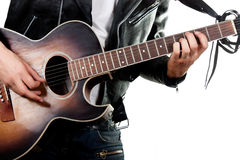 Guitarist playing on acoustic guitar. Guitarist playing on a old acoustic guitar isolated on white background royalty free stock photo