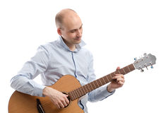 Guitarist playing acoustic guitar Stock Photo