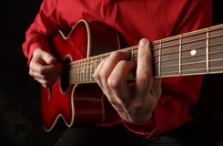 Guitarist. Guitarist playing an acoustic guitar Royalty Free Stock Images