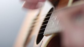 Guitarist playing acoustic guitar stock video footage