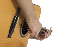 Guitarist playing acoustic guitar, closeup Stock Photography