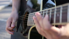 Guitarist Playing on Acoustic Guitar on Street stock video