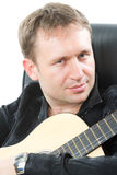 Guitarist playing acoustic six-string guitar Stock Photos
