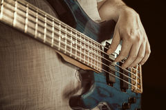 Guitarist playing bas guitars Stock Photo