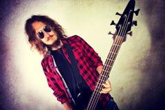 Guitarist playing bass guitar. Royalty Free Stock Image