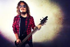 Guitarist playing bass guitar. Stock Photos