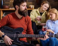 Guitarist playing at birthday, celebration concept. Bearded man performing guitar solo. Man with stylish beard. Guitarist playing at birthday, celebration stock photo