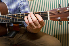 Guitarist Playing Chords Stock Images