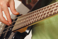 Guitarist playing the electric bass guitar close up Stock Photos