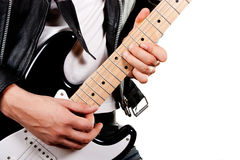 Guitarist playing on electric guitar. Isolated on white background stock images