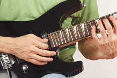 Guitarist playing the electric guitar close up Royalty Free Stock Image