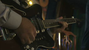 Guitarist playing on electric guitar in the club stock video