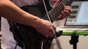 Guitarist playing electric guitar. Professional guitarist playing electric guitar close up process stock video footage