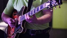 Guitarist playing electric guitar stock video footage